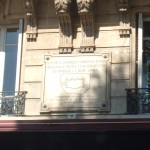 Stone historical plaque on a building in the Place de la Bastille with an outline of the fortress