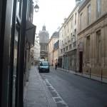 View back down the rue de Sévigné towards the boulevard and the church