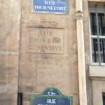 Rue Tournefort with its old street sign for the Rue Neuve-Ste-Geneviève still carved into the wall